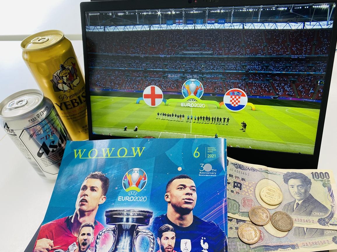 PD画面に映るEURO2020のイングランド×クロアチア戦の中継とビール2本、現金2,530円の画像