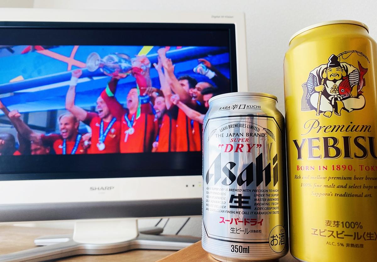 euro2016で優勝したポルトガル代表が映るテレビとビール2本の写真